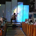 Morgan Szymanski performing EstrEllita in Holy Trinity Church, Leamington Spa, Estrallita projected